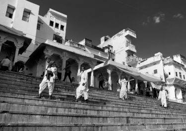 Black and White Photography with the title 'India 1'. Portrait of four indian men on stairs.