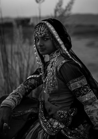 Black and White Photography with the title 'India 9'. Portrait of an Indian Girl in traditional Costume.
