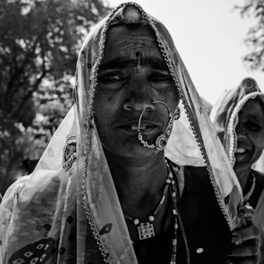 Black and White Photography with the title 'India 11'. Portrait of an Indian woman with a nose ring.