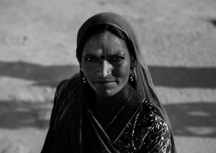Black and White Photography with the title 'India 14'. Portrait of an Indian woman with a headscarf.