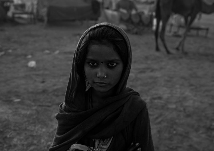Black and white photography with the title 'India 15'. Portrait of a young Indian Girl with a headscarf.