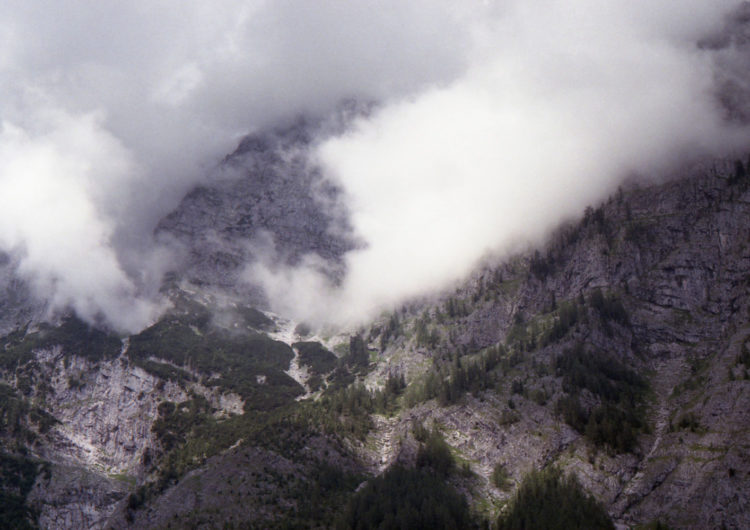 analogue landscape photography of mountains surrounded by clouds with the title 'Massif III' - photographed by Katrin Mainusch - friendmade.fm
